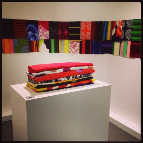 Fabric swatches (on walls) and bolts of various Marimekko Oy fabrics.