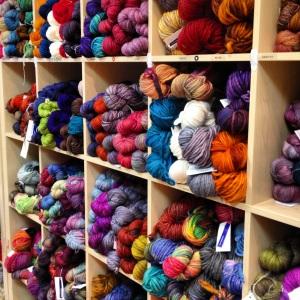Pictured are three different weights of Malabrigo yarn: Rios, Rastita, and Rasta