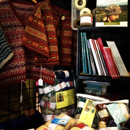 The fair isle samples at Sheep's Ahoy. I particularly like the Redbird Vest hanging on the left.