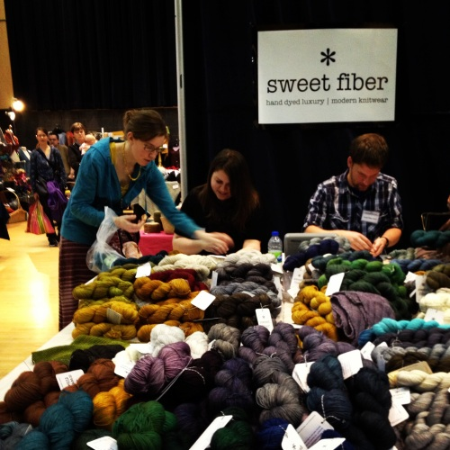 Melissa Thomson at the table with her beautiful yarns.